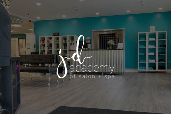 JD Academy school logo over image of entrance to college