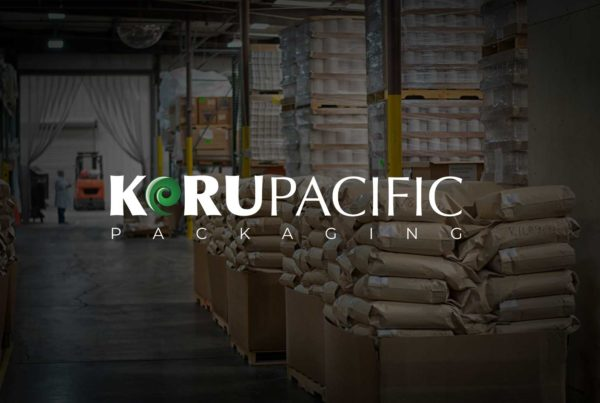 Koru Pacific Packaging Logo over image of their warehouse